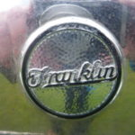 The radiator-mounted Franklin logo on chrome, not nickel as recently used.