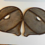 "A good pair of 19th Century beaver tail snow shoes, the fine sinew intricately woven to cover the pear shaped stretchers, retaining traces of red trade wool decoration, possibly Mohawk, h. 27"" x w. 25""."