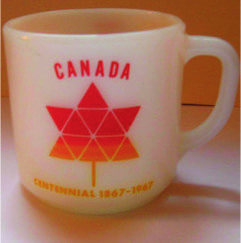 "A 5.5"" mug from the Magnetic Hill, Nova Scotia, ""Where cars coast uphill"""