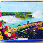 Small candy container Niagara Falls on the lid. May have contained salt water taffy.