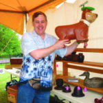 Stephen Meinhardt holds up a great little Yogi Bear ride-on toy, priced at $125.