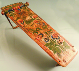 "An important mid 19th Century Mohawk cradleboard, the tapering body chip carved with an all over design of flowers, leaves and birds, with a crenulated top, turned stretcher and bentwood hoop, retaining original paint and hide fastenings, inscribed au verso in pencil ""Marguerite Mountome, Kalanaka, 62 ans?"", purchased in Caughnawaga in 1928."