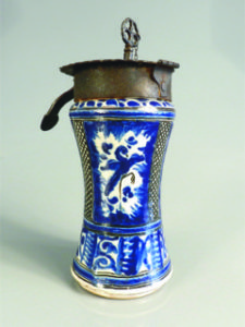 "An 18th C. Mexican majolica albarello jar, blue and white, mounted with an iron lock with original key, 9"" high."