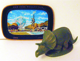 Wax Sinclair Oil dinosaur from the 1964-65 New York World's Fair and a small tray given away at the USS Steel Building. The image on the tray is of the giant Unisphere which was the symbol of the fair.