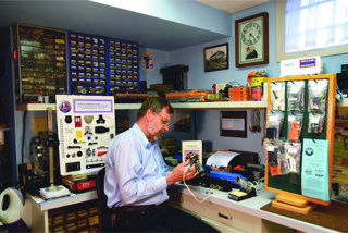 """Helmut Ostermann at work on a train set """"I've always enjoyed being able to use my skills to repair and restore these classics from the past."""""""
