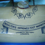 Ed & Marie Hrelec Antiques Late 1800s ( display only) Doulton's Foot Warmer manufactured at Lambeth Pottery, London $125 as found. Call 905-355-3557