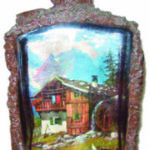 1930s German liquor bottle made to appear as a tree. Inside a scene from the Alps