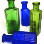 """Marked poison bottles -green bottles embossed """"not to be taken"""" Photo courtesy of Nostalgic Journey"""